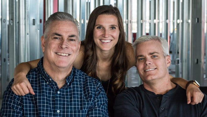 Tim Hattrick (from left), Brooke Harvey and Ben Campbell form the new morning-show team on KNIX-FM (102.5).
