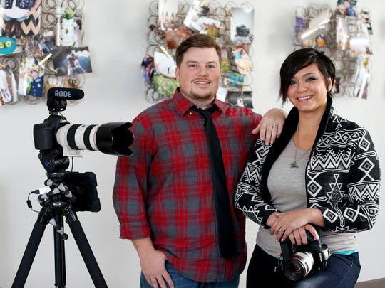 Charley and Amber Fern opted to move from a Central Avenue office to a bigger Great Falls house with room for both of their photo studios. Working from home saves money, they said.