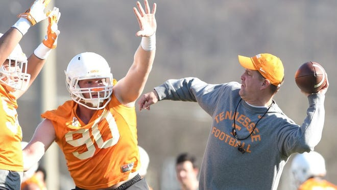 Tennessee defensive lineman Charles Folger, left, practices blocking a pass by UT defensive coordinator Bob Shoop during spring practice at Haslam Field on Tuesday, March 8, 2016.