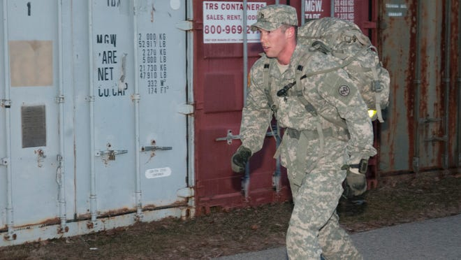 Staff Sgt. Christian Hager competes in the ruck march event Sunday, March 29, 2015. The march was the culminating event of the competition.