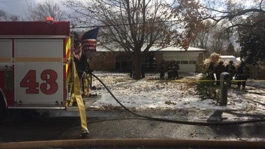 A woman and two dogs died after a fire in this house in the 6700 block of East 20th Street on Tuesday, Nov. 18, 2014.