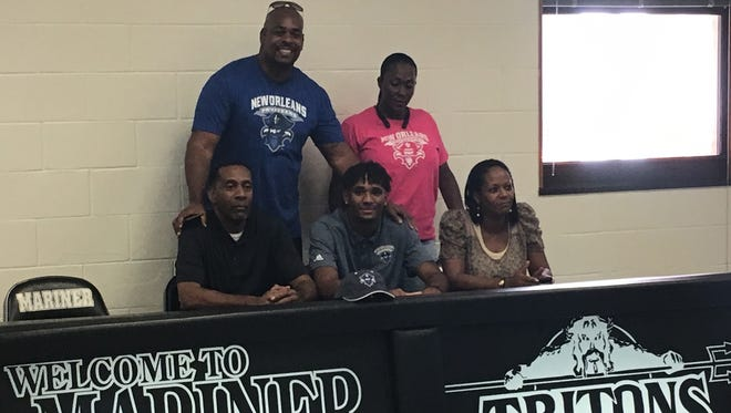 Mariner High basketball player Jahmel Myers signed a scholarship with the University of New Orleans on Nov. 8.