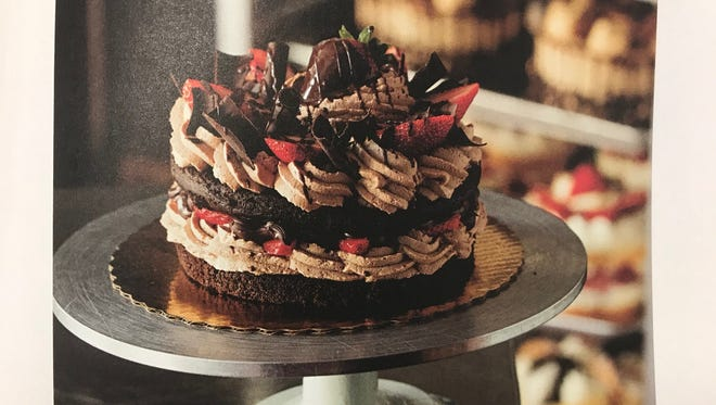 "This chocolate shortcake from Buddy Valastro, which is featured in ""America The Great Cookbook"", is filled with chocolate mousse and sliced strawberries."
