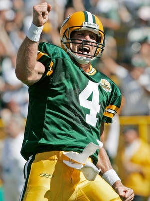 FILE - In this Sept. 23, 2007, file photo, Green Bay Packers quarterback Brett Favre reacts after throwing a touchdown pass to Bubba Franks during the first half of an NFL football game against the San Diego Chargers in Green Bay, Wis. Favre is a finalist for the Pro Football Hall of Fame. (AP Photo/Morry Gash, File)