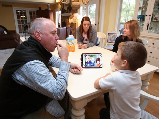 Rusty Collinsworth, left, shares snacks with Decklan Murphy, 5, as his wife Michelle Collinsworth, right, and their daughter Lindsey Collinsworth look on.  Lindsey is engaged to Decklan's father Evan Ober.  Evan and Lindsey were both forced into sobriety by a Kentucky law called Casey's Law.  They plan to marry soon.