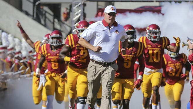 Coach Paul Rhoads take the field before their game with Iowa Saturday Sept. 12 2015, at Jack Trice Stadium in Ames, Iowa.