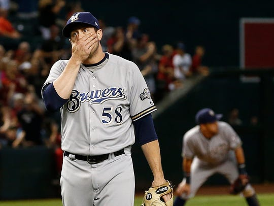 Milwaukee Brewers relief pitcher Rob Scahill pauses