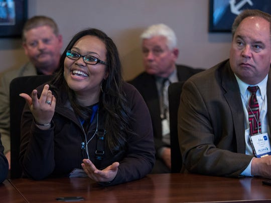 Jazyme Thomas, a community development program specialist with the city of Port Huron, participates in a discussion during a tour of the Blue Water Bridge U.S. Customs and Border Protection operations as part of a Michigan Local Government Management Association conference Thursday, Feb. 4, 2016 in Port Huron.