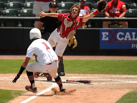 A throw flies out of the reach of Albany catcher Adam