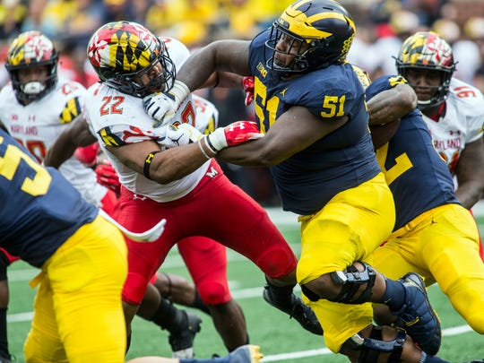 Maryland inside linebacker Isaiah Davis (22) is blocked by Michigan offensive lineman Cesar Ruiz (51) in the second quarter of an NCAA college football game in Ann Arbor, Mich., Saturday, Oct. 6, 2018. (AP Photo/Tony Ding)