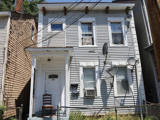 This home at 30 Hillman St. in Paterson is in negotiations to be sold through the city's buyout program for homes in flood-prone areas on the Northside.