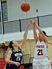 Shannon Dingman (21) goes up for two of her 13 points