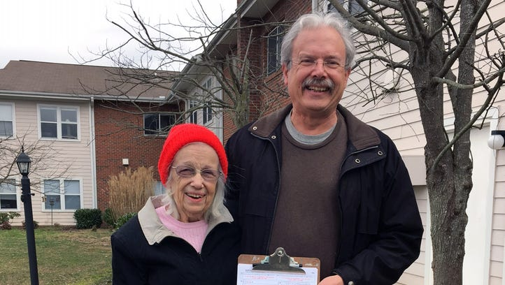 Reba Miller Bowser, left, and her son, Ed Bowser, hold North Carolina voter ID documents after Miller Bowser was given a state photo ID Feb. 12, 2016. She had been rejected four days earlier.
