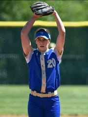 Reed's Julia Jensen winds up for a pitch against Damonte during their regional playoff game at Bishop Manogue high on Friday.