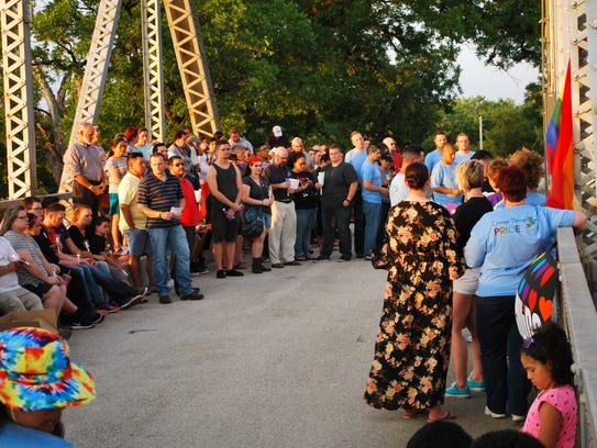 More than 100 people attend a candlelight vigil Monday,