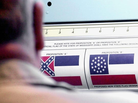 A voter considers his options for state flag on April 17, 2001. Voters overwhelmingly supported the 1894 flag, which contains the Confederate emblem.