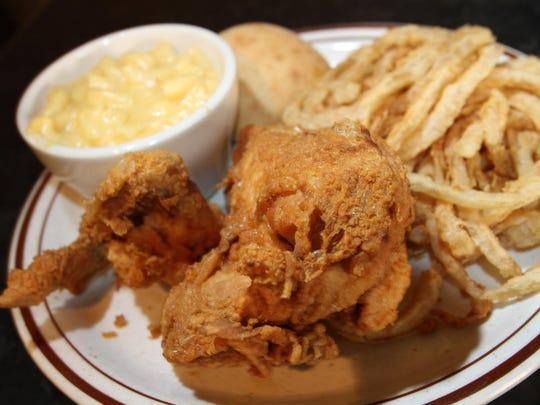 Enjoy comfort food like broasted chicken with macaroni