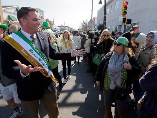 Belmar Mayor Matt Doherty works the crowd along Main