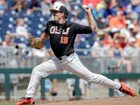 Oregon State pitcher Luke Heimlich (15) throws against