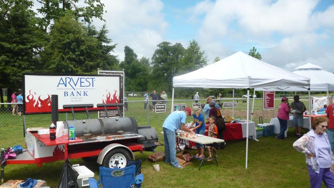 The first Bark at the Park at the Mountain Home Dog Park was a success. Shown are the Arvest Bank barbecue rig and several of the booths. In addition to hot dogs donated by Arvest Bank and additional food and beverages donated by Harps on U.S. Highway 62 West, door prizes donated by local businesses were awarded every 15 minutes. The event was to bring awareness to the the dog park in Keller Park on Rossi Road, which has separate fenced areas for small and large dogs.