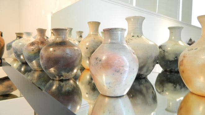 Saggar pottery by Angi Peterson of Wabash Valley Potters is on display at the Tippecanoe Arts Federation.
