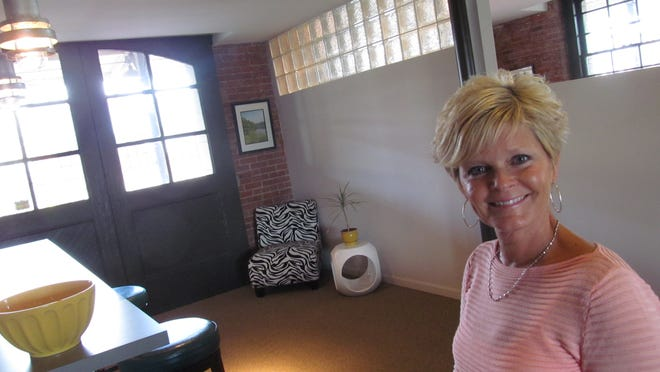 Stephanie Blodgett shows off the downtown office of her business, Ad Elements, located in the former Lackawanna Railroad station. She believes good leaders need to work hard, surround themselves with talented employees and come to the office every day.