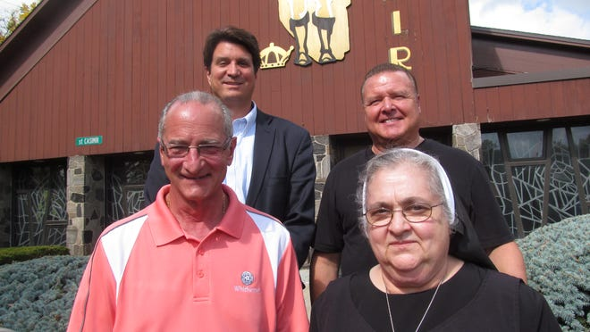 Organizers stand in front of the former St. Casimir's Church in Endicott. They are working to open the church as Mercy House, a home for the terminally ill. The organizers are clockwise Sister Joanna Monticello, executive director; Dave DeAngelo, business manager; Anthony Paniccia, board president; and the Rev. Clarence Rumble, pastor of Church of the Holy Family.