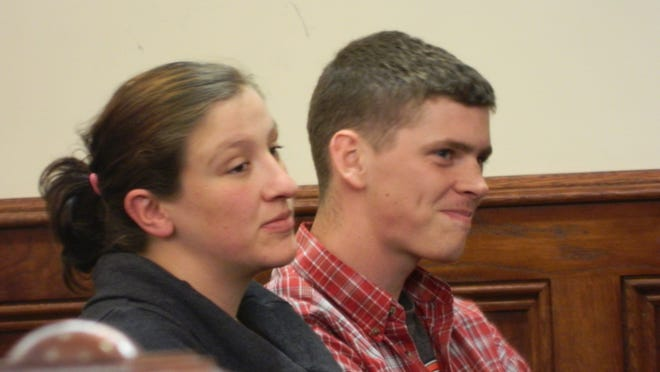 Nicole and Eric Hulbig appeared in court on vandalism charges but the preliminary hearing was reset to Dec. 2. They shared a number of smiles inside and outside the courtroom despite the presence of demonstrators.