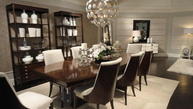 Mid-century modern dining with pedestal table, chairs and bookcase, all in hand-rubbed porter finish.