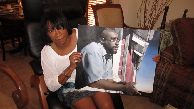 Joyce King holds a photo of James Woodard, a man who had been wrongly imprisoned who she later developed a relationship with.