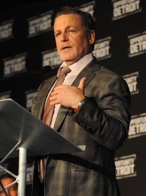 Dan Gilbert announces Bedrock Real Estate Services will sell its first downtown building to major auto supplier Lear Corp., which is setting up a design studio in Capitol Park.