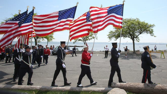 Members of the Nyack Fire Department carry flags during the Nyack Memorial Day Parade May 25, 2015.