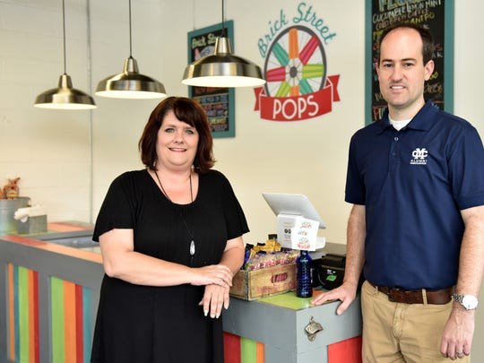 Connie Chrietzberg is the manager and Clay Mansell is the owner of the new Brick Street Pops at the corner of Leake and Monroe streets in Clinton.