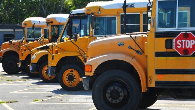FILE - School buses