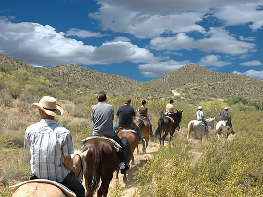 Spur Cross Stable offers guided trail rides ranging from an hour to a full day for all experience levels.