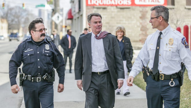 Left to right, IMPD Officer Carlos Trincado, Indianapolis Mayor Joe Hogsett, and IMPD Police Chief  Bryan Roach, walk the neighborhood around west Washington St. talking with residents about deportation fears, and how IMPD will approach immigration status while policing the community, March 2, 2017.