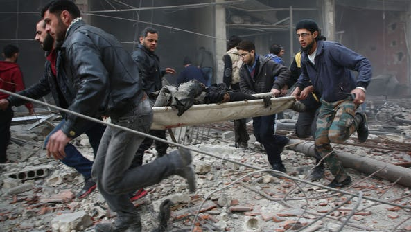 Syrian rescue workers evacuate badly injured people