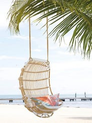 Double Rattan Hanging Swing via Serena & Lily.