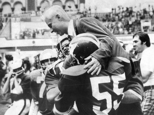 - - Atlantic City, 12/4/74- Art Post (550 and Brick Township High School teammates acrry Coach Warren Wolf off field after 21-20 triumph last night over Camden that gave Green Dragons the NJSIAA Group IV South Jjersey Championship. Frank Beardsley/staff photographer
