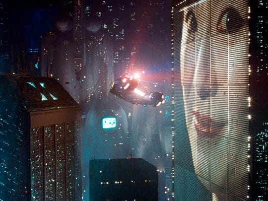 A flying spinner car zips through the wondrous night environment of 2019 L.A. in the original 'Blade Runner.'