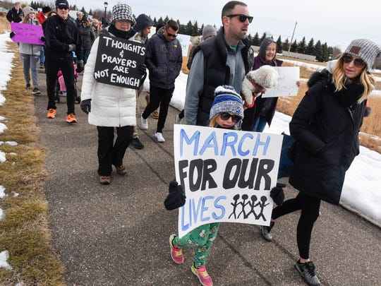 People leave Sartell City Hall during a March For Our Lives event Saturday, March 24, in Sartell.