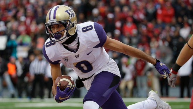 Washington wide receiver Dante Pettis, shown scoring against Washington State last season, is competing in track and field for the Huskies this spring.