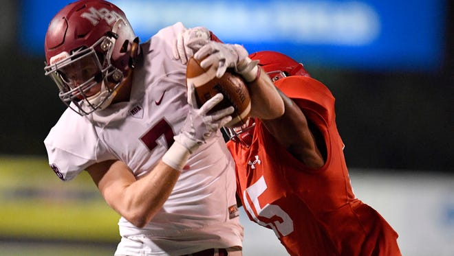 Brentwood Academy's Kenyon Garlington (15) breaks up a pass intended for MBA's Clint Blackwell (7) during the first half of the Division II-AAA state championship game at Tucker Stadium in Cookeville, Tenn., Saturday, Dec. 2, 2017.
