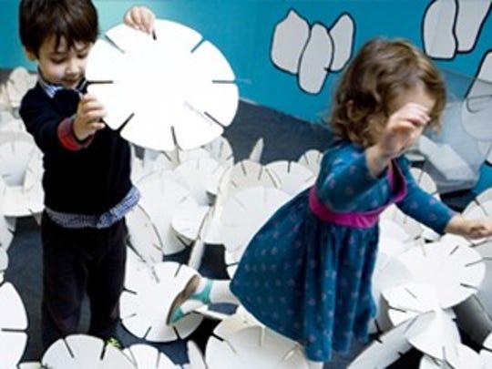 """Children play during """"Winter Recess Wonderland"""" at the Children's Museum of Manhattan."""