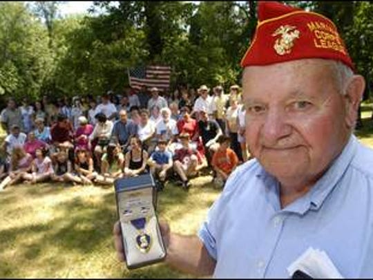 World War II veteran Marcel Bisson was awarded a second purple heart (he lost the first one) at a family picnic held in Sheboygan in July 2007.