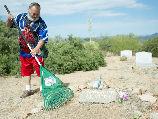 Robert Brooker, of Organ, New Mexico,  works to clean