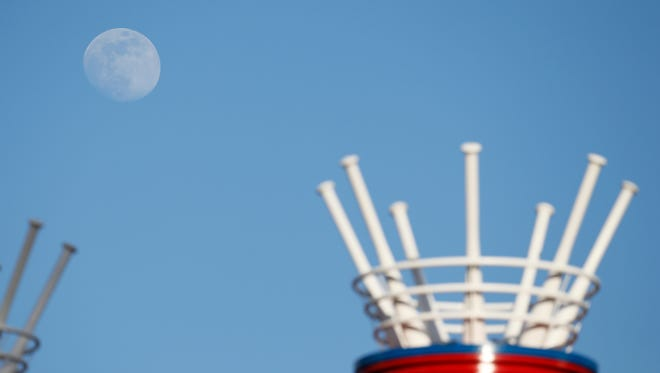 The moon rises over the power stacks in center field during the second inning of the Cincinnati Reds game against the St. Louis Cardinals at Great American Ball Park on June 6, 2017.