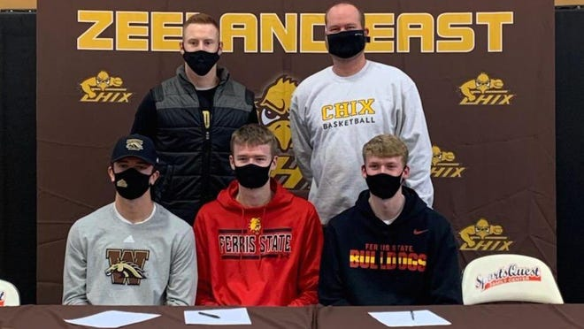 Zeeland East's Ethan Houghtaling (left), Nate Claerbaut and Brandon Claerbaut signed national letters of intent on Saturday.