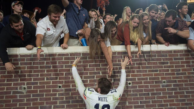 Auburn quarterback Sean White (13) celebrates with fans after the NCAA football game between Auburn and Mississippi at Vaught-Hemingway Stadium on Saturday, Oct. 29, 2016, in Oxford, Miss. Auburn defeated Mississippi 40-29.Albert Cesare / Advertiser