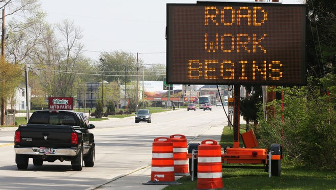 A road sign along Calumet Avenue notifies motorists of pending road work on Tuesday, May 16, in Sheboygan.